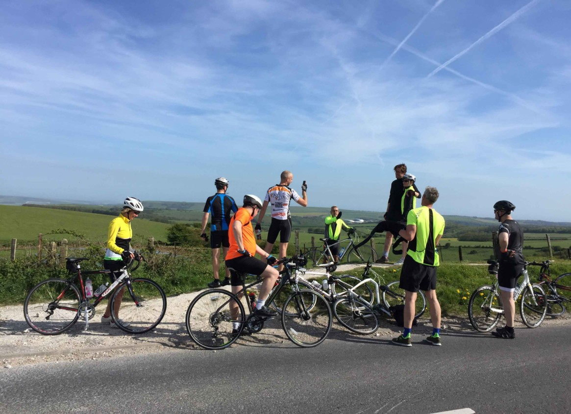 Photo of the riders in the London to Brighton Bike Ride at the highest point of the ride