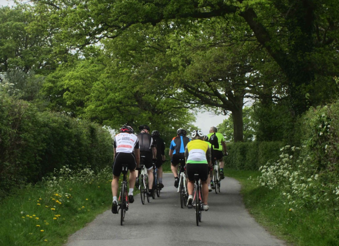 Photo of the riders in the London to Brighton Bike Ride going down a country lane