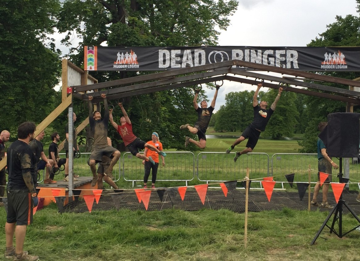 Photo of runners at Tough Mudder going through the obstacle Dead Ringer