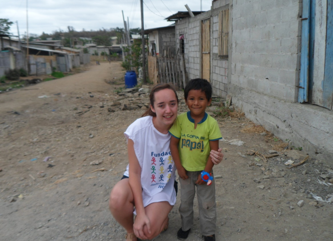 Photo of International Children's Trust staff member Nicola with a young boy at JUCONI in Ecuador