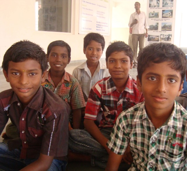 Photo of 5 boys at Gummidipoondi sitting cross legged on the floor