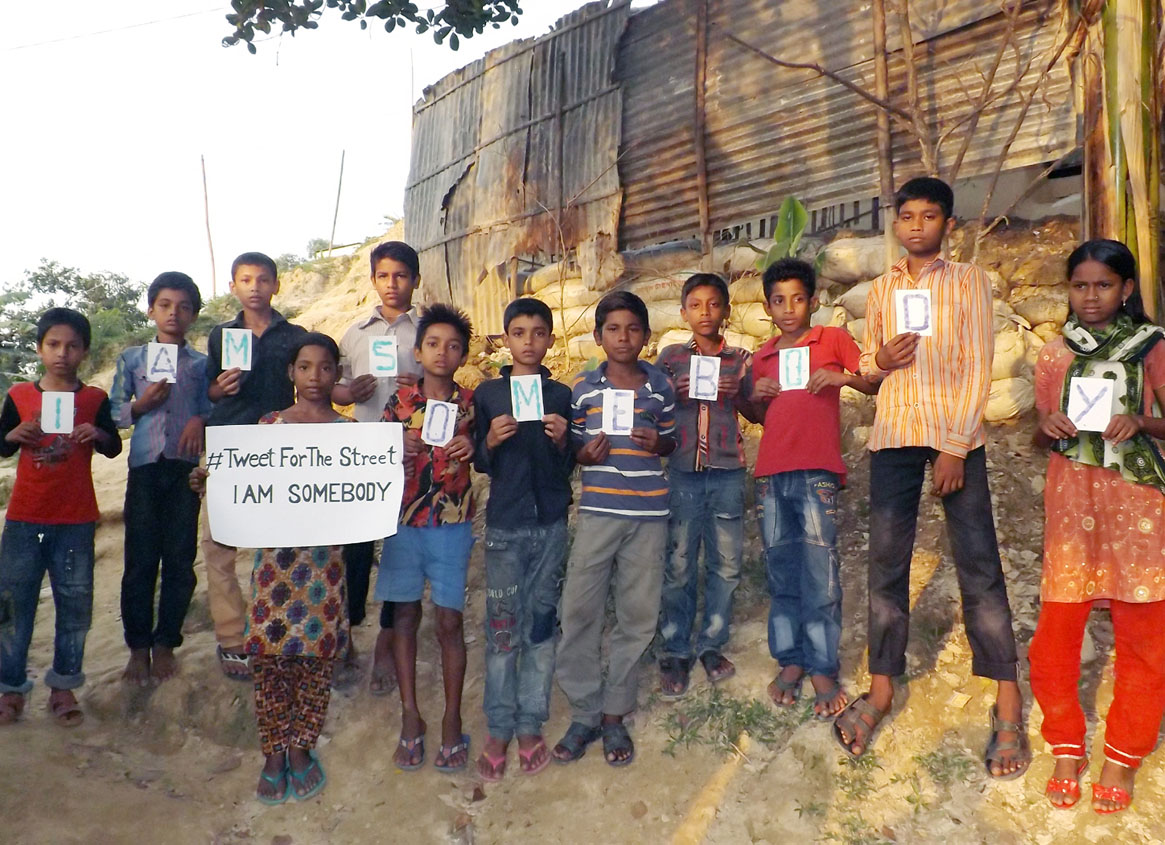 Photo of children at BISAP, Bangladesh holding their fingerprint artwork for the I Am Somebody campaign.