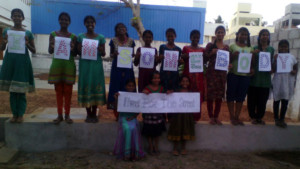 Photo of the girls of the Barbara Kelly Home in Chennai, India holding their fingerprint artwork for the I Am Somebody campaign.