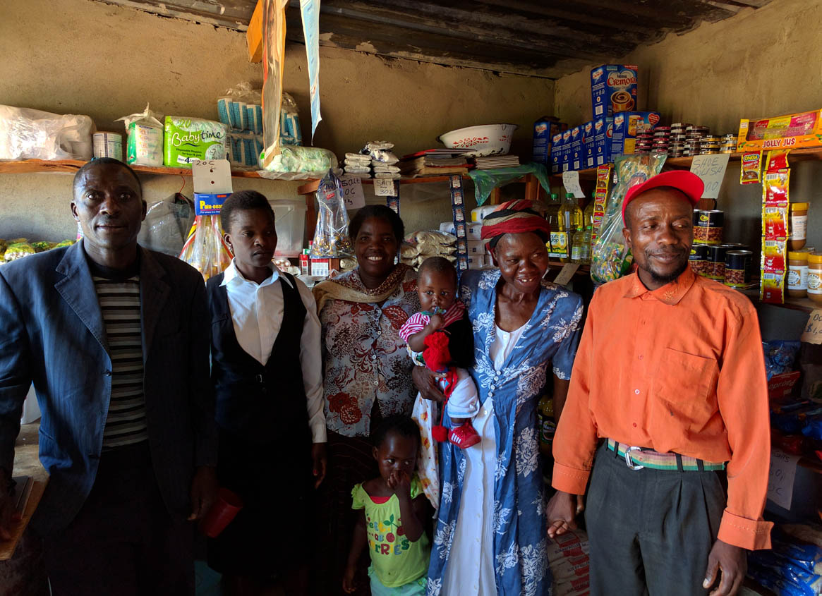 Photo of members of a microloan group in a small shop they have started just outside of Harare, Zimbabwe