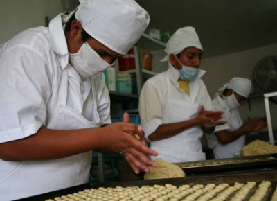 Photo of boys making biscuits in the JUCONI workshop