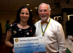 The International Children's Trust being presented with a cheque by the President of the Rotary Club of Coventry
